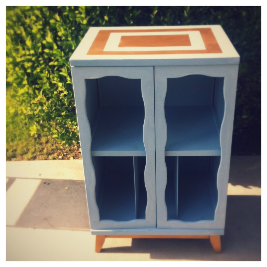 Vintage record cabinet.  Perfect for cake or a drinks station.
